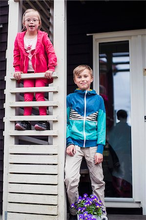 Portrait of brother and sister at porch Stock Photo - Premium Royalty-Free, Code: 698-07635698