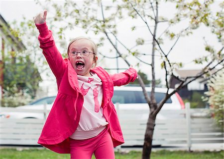 Excited girl with arms outstretched enjoying in lawn Stock Photo - Premium Royalty-Free, Code: 698-07635705