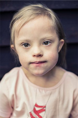 Thoughtful girl with down syndrome looking away Stock Photo - Premium Royalty-Free, Code: 698-07635739