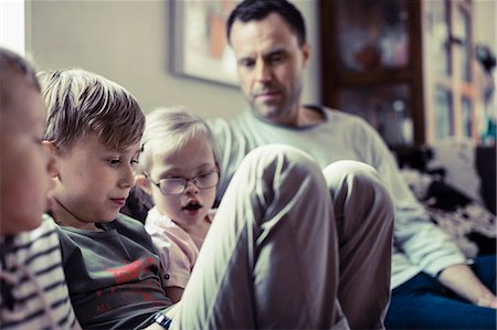 Siblings sitting with father in house Stock Photo - Premium Royalty-Free, Code: 698-07635731