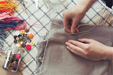 design (motif, artistic composition or finished product) - High angle view of woman stitching fabric on table at home Stock Photo - Premium Royalty-Free, Code: 698-07812936