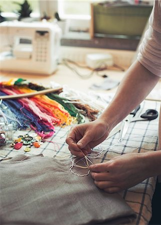 design (motif, artistic composition or finished product) - Cropped image of woman stitching fabric on table at home Stock Photo - Premium Royalty-Free, Code: 698-07812938