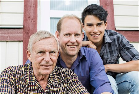 Portrait of multi-generation family sitting together outside house Stock Photo - Premium Royalty-Free, Code: 698-07812989