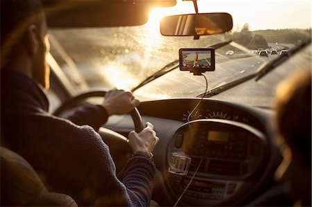 Cropped image of man driving car while using GPS by daughter Stock Photo - Premium Royalty-Free, Code: 698-07813047