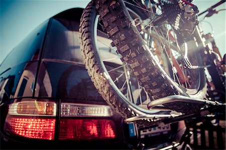 day - Cropped image of mountain bike tied to car Stock Photo - Premium Royalty-Free, Code: 698-07813051