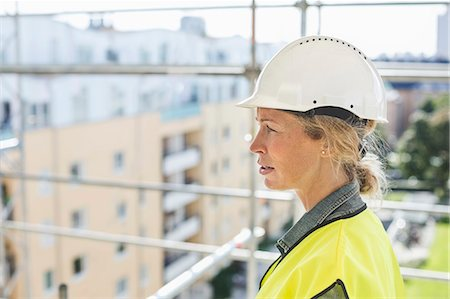 female - Side view of female architect at construction site Stock Photo - Premium Royalty-Free, Code: 698-07813099