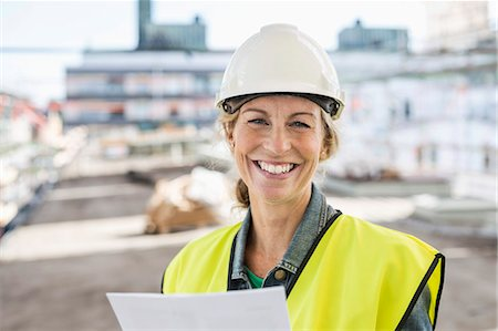 Portrait of happy female architect at construction site Stock Photo - Premium Royalty-Free, Code: 698-07813103