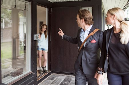 Parents instructing daughter while leaving home Stock Photo - Premium Royalty-Free, Code: 698-07813187