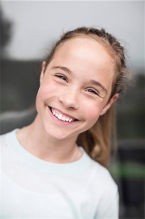 preteen  smile  one  alone - Portrait of happy girl outdoors Stock Photo - Premium Royalty-Free, Code: 698-07813181