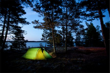 Tent with trees on lakeshore at dusk Stock Photo - Premium Royalty-Free, Code: 698-07944479