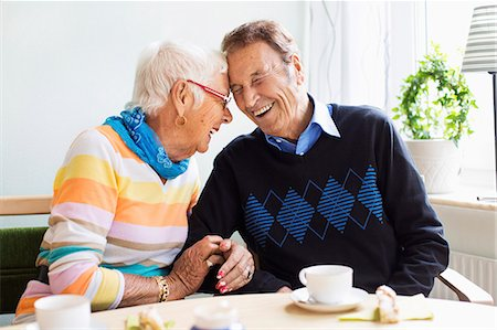 senior women - Loving senior couple laughing at nursing home Stock Photo - Premium Royalty-Free, Code: 698-07944494