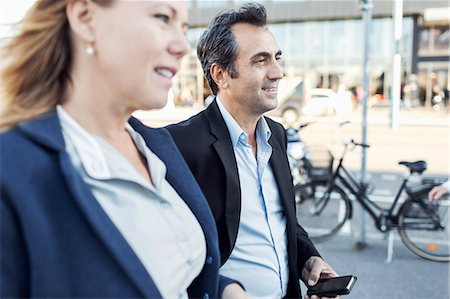Businesspeople looking away while walking on street Stock Photo - Premium Royalty-Free, Code: 698-07944666