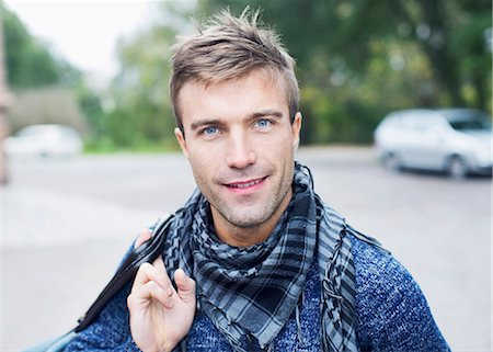 fashion - Portrait of smiling young man on street Stock Photo - Premium Royalty-Free, Code: 698-07944696