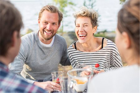 Happy friends enjoying during lunch at picnic table Stock Photo - Premium Royalty-Free, Code: 698-08007831