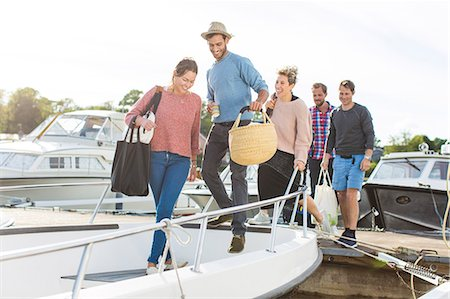 Friends boarding yacht against sky Stock Photo - Premium Royalty-Free, Code: 698-08007847