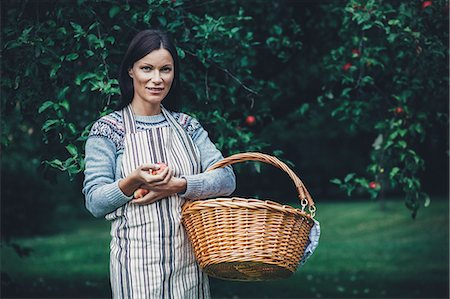 single fruits tree - Portrait of woman carrying wicker basket at apple orchard Stock Photo - Premium Royalty-Free, Code: 698-08007955