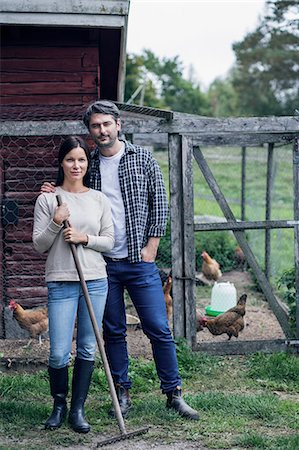 five animals - Portrait of couple standing at poultry farm Stock Photo - Premium Royalty-Free, Code: 698-08007950