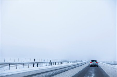Car on E4 highway during winter against clear sky Stock Photo - Premium Royalty-Free, Code: 698-08008038