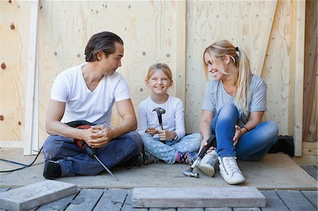 diy or home improvement - Family sitting on porch of house being renovated Stock Photo - Premium Royalty-Free, Code: 698-08008077