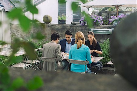 europe coffee shop - Couples having lunch at outdoor cafe Stock Photo - Premium Royalty-Free, Code: 698-08008185