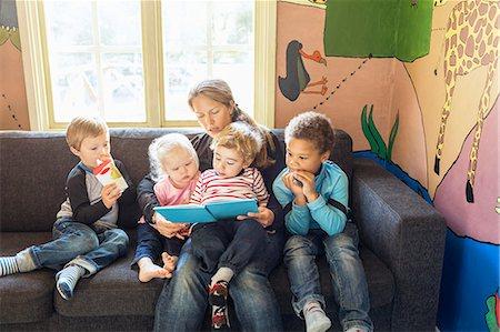 Teacher telling story to children in kindergarten Stock Photo - Premium Royalty-Free, Code: 698-08008293