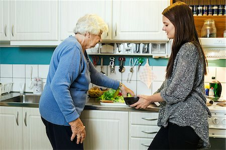 Grandmother and granddaughter preparing food in kitchen Stock Photo - Premium Royalty-Free, Code: 698-08081495