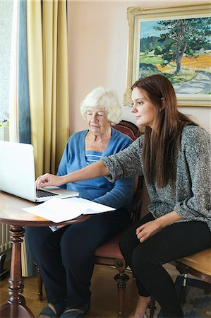 Grandmother and granddaughter using laptop together at home Stock Photo - Premium Royalty-Free, Code: 698-08081490