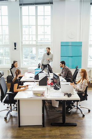 Business people at computer desks in creative office Stock Photo - Premium Royalty-Free, Code: 698-08081639