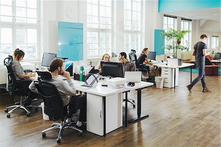 Business people working at desks in creative office Stock Photo - Premium Royalty-Free, Code: 698-08081645