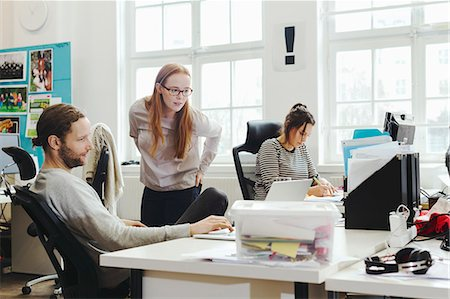 Creative business people working at desk in office Stock Photo - Premium Royalty-Free, Code: 698-08081641