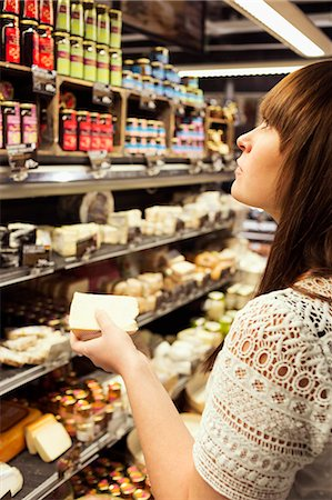 Woman shopping cheese in supermarket Stock Photo - Premium Royalty-Free, Code: 698-08081811
