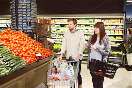 Couple buying groceries at supermarket Stock Photo - Premium Royalty-Free, Code: 698-08081839