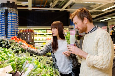 Young couple selecting vegetables at supermarket Stock Photo - Premium Royalty-Free, Code: 698-08081842