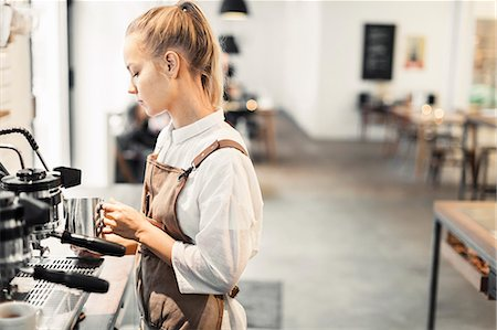 restaurant - Young female barista using espresso maker at cafe Stock Photo - Premium Royalty-Free, Code: 698-08170873