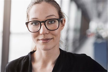 female - Portrait of confident businesswoman in office Stock Photo - Premium Royalty-Free, Code: 698-08170946