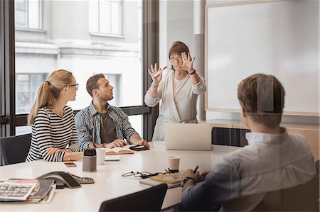 presentation (displaying) - Senior businesswoman giving presentation to colleagues in board room Stock Photo - Premium Royalty-Free, Code: 698-08170969