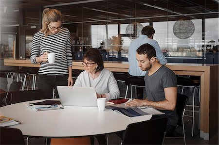 Business people working at office cafe Stock Photo - Premium Royalty-Free, Code: 698-08170985