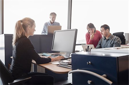 Business people working in office Stock Photo - Premium Royalty-Free, Code: 698-08170995