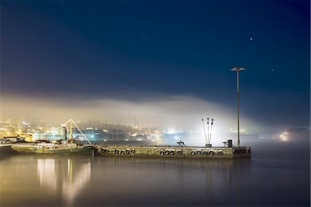 Illuminated commercial dock on lake at night Stock Photo - Premium Royalty-Free, Code: 698-08226272
