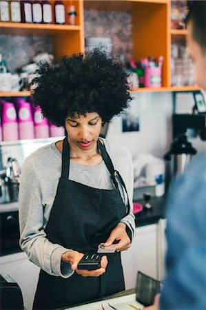 european cafe bar - Barista using credit card reader to make payment in cafe Stock Photo - Premium Royalty-Free, Code: 698-08226427