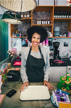european cafe bar - Portrait of happy female barista with serving tray in cafe Stock Photo - Premium Royalty-Free, Code: 698-08226429