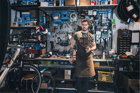 Portrait of confident mechanic at workbench Stock Photo - Premium Royalty-Free, Code: 698-08226438