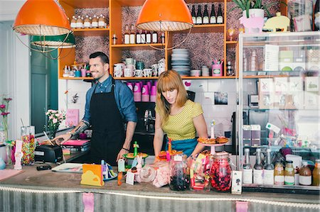 european cafe bar - Man and woman working at cafe counter Stock Photo - Premium Royalty-Free, Code: 698-08226446