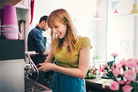Happy barista using coffee maker in cafe Stock Photo - Premium Royalty-Free, Code: 698-08226447