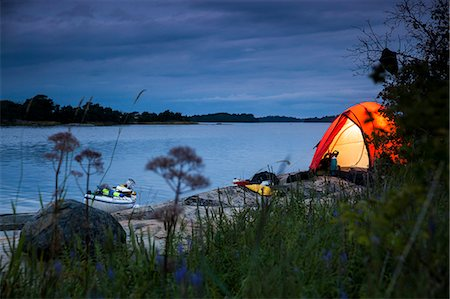 Tent at lakeshore during dusk Stock Photo - Premium Royalty-Free, Code: 698-08226517