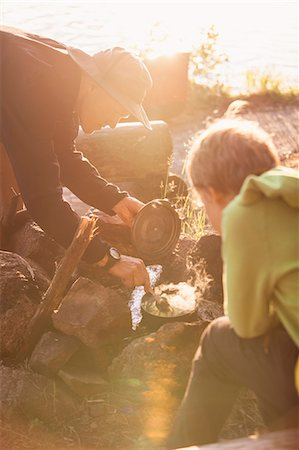 preteen beach - Father and son preparing food at campsite Stock Photo - Premium Royalty-Free, Code: 698-08226527