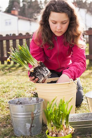 plant (botanical) - Girl planting pot at yard Stock Photo - Premium Royalty-Free, Code: 698-08226531