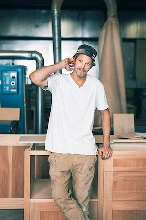 Portrait of confident carpenter standing in workshop Stock Photo - Premium Royalty-Free, Code: 698-08226691