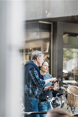 Senior couple using digital tablet outdoors Stock Photo - Premium Royalty-Free, Code: 698-08226766
