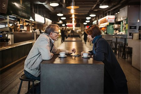europe coffee shop - Side view of senior couple having coffee at cafeteria Stock Photo - Premium Royalty-Free, Code: 698-08226795